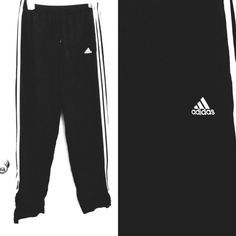 Women's Adidas Track Pants. Size Medium. Women's Adidas track pants. Size medium. Manufactured by Adidas. Made in Indonesia. Polyester fabric. Bottoms are not tight in the ankles like joggers. There are zippers on each ankle so you have the option to wear them zipped or not. Third photo shows the ankles unzipped. These have been worn a few times, but they are in excellent condition. Adidas Pants Track Pants & Joggers