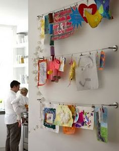 Clever way to hang kids artwork