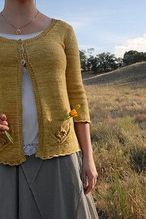 A lightweight, ¾-sleeve cardigan perfect for layering on a brisk spring day. The sweater style itself is basic and flattering while the flower motif pockets and delicate edging add just enough feminine detail. Wildflower is knit in pieces from the bottom up and seamed together at the end.