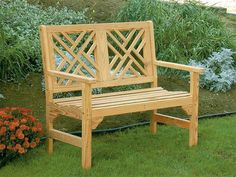The Amish Pine Wood 4' Chippendale Garden Bench fits right into the garden with its solid wood beauty that includes 2 seats, cutout back detail, and the options to have it made to order with water sealant already applied and up to two cupholders. #gardenbench #outdoor #seating #wooden