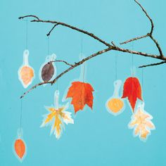Leaf Mobile - I might try dipping the leaves in wax instead of the contact paper
