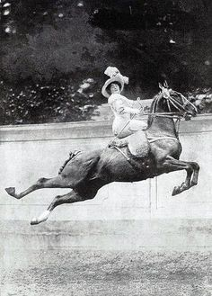 Jumping while riding side saddle! This Mama is Hardcore!!