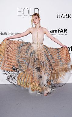 Elle Fanning from 2016 amfAR Cinema Against AIDS Gala  The actress showed off the intricate design of her gown while posing on the carpet.