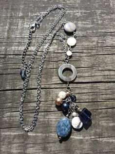 Items similar to Long necklace precious stones, lapis lazuli , freshwater pearl, Swarovski pearl, shell on Etsy Lapis Lazuli, Stainless Steel Necklace, Swarovski Pearls, Shades Of Blue, Fresh Water, Shells, Bronze, Etsy, Pendant Necklace