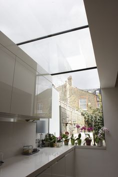 A kitchen extension from inside, with a roof light House, House Extensions, Home, Glass Extension, Roof Styles, Roofing Diy, House Inspiration, New Homes, House Interior