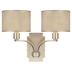 Featuring a winter gold finish and fabric drum shades, this glamorous sconce is perfect for illuminating an intimate reading nook or adding hotel-chic style ...