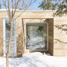 Two outdoor spaces bookend this longitudinal home by Atelier Pierre Thibault, which nestles into the ground at one end and is raised up at the other.
