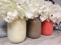 Painted Coral, Taupe, and White Mason Jars. Perfect for Gifts, Home Decorations, and Weddings.