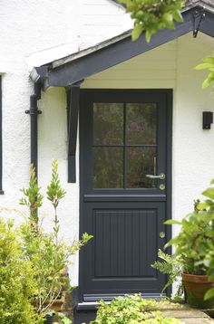 This anthracite stable door nestles into this white painted brick cottage perfectly. Cottage Front Garden, Brick Cottage, Cottage Door, Glazed External Doors, External Front Doors, Timber Front Door, Double Front Doors, Doors And Floors, Windows And Doors