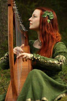 Celtic:  #Harp and red-haired maiden. this makes me think of Ce'Nedra....though i don't think she plays a harp.