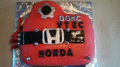 Honda car motor cake for a broom