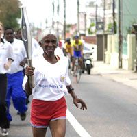 PEOPLE YOU SHOULD KNOW. 74-year-old 'Granny' Luces carries the Baton. Granny is an active marathon runner in Trinidad. LUV YOU GRANNY LUCES