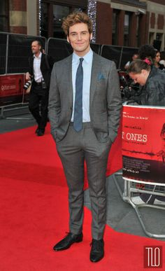 """Sam Claflin in Burberry at """"The Quiet Ones"""" London Premiere"""