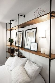 Would need a guard to block things from falling off the shelves, things like books. Industrial Wall Plumbing Pipe Shelves by ModernIndustrialCA Plumbing Pipe Shelves, Diy Pipe Shelves, Plumbing Pipe Furniture, Bathroom Plumbing, Industrial Furniture, Industrial Lamps, Furniture Vintage, Vintage Industrial, Kitchen Furniture