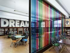 St. Louis Public Library / Cannon Design |  Great use of color and a simple dividing wall that creates diverse spaces
