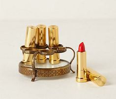 "Little Splurges, Big Statements: Lip Service. This object gives new meaning to the word ""adorbs."" Anthropologie's lipstick holder, $28, will fit daintily on her dresser for a bit of retro glamour. Stock it with a range of reds for an unexpected surprise. #SelfMagazine"