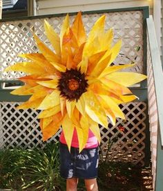 Make a Giant Paper Sunflower for $1 UMMM WE COULD MAKE THEM ALL DIFFERENT COLORS/SIZES AND STAGGER ON A WALL!? cute.
