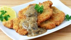 Jaeger Schnitzel is a classic German dish of crispy breaded fried pork chops covered in mushroom gravy – perfect for a hearty winter meal.