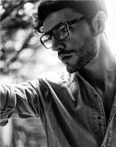 Glasses and a slightly unbuttoned shirt.