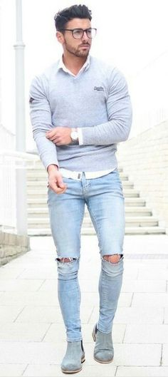 Dress in a grey v-neck pullover and baby blue distressed slim jeans for a trendy and easy going look. A pair of grey suede chelsea boots will bring a strong and masculine feel to any ensemble.