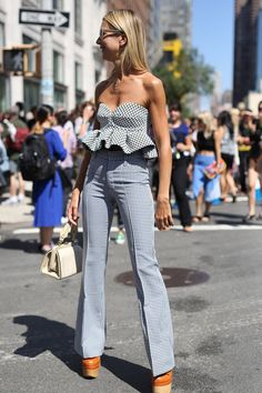 Pin for Later: All the Best Street Style From New York Fashion Week NYFW Street Style Day 4 Natalie Joos was a master at playful proportions in a peplum-trimmed bustier and flares. Best Street Style, Looks Street Style, Nyfw Street Style, Street Style Summer, Cool Street Fashion, Street Chic, Love Fashion, Fashion Looks, Fashion Design