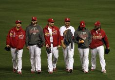 Members of the bull pen walk on the field after the Cardinals 8-3 victory over the San Francisco Giants in Game 4 of the National League Championship Series between the St. Louis Cardinals and the San Francisco Giants on Thursday, Oct. 18, 2012, at Busch Stadium. Photo By Laurie Skrivan, lskrivan@post-dispatch.com