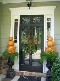 """Fall Decor, Fall is my favorite time of year. I absolutely love the colors of the season. I decorate my exterior with numerous """"faux"""" pumpkins yearly., Large antique urns hold pumpkin topiaries twined in bittersweet., Home Exterior Design Decor, Fall Outdoor Decor, Fall Front Door, House Exterior, Exterior Design, Fall Decor, House Designs Exterior, Fall Front, Pumpkin Topiary"""