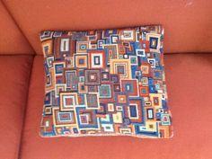 Pillow made of knitting yarn. Design Kaffe Fassett.