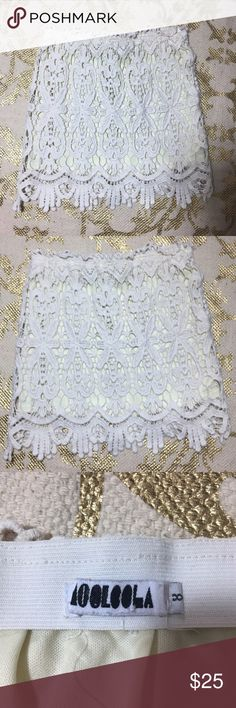 Lf White Lace Stretchy Elastic crochet mini skirt this Lf White cream Lace Stretchy Elastic patterned crochet mini skirt. Fits like an XS to S LF Skirts Mini
