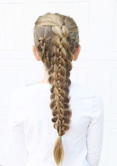4 strand braids interwoven and topped with another 4 strand braid.  Looks complex but just utilizes as simple braiding technique!