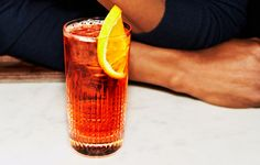 The 'Rol & Rye: 1-1/2 oz Aperol  & 1-1/2 oz rye or bourbon whiskey in a highball glass filled with ice. Top with club soda & garnish with an orange wheel.