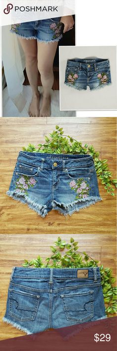 """American Eagle Festival Floral Embroidery Shorts NWOT American Eagle Outfitter hot mini denim shorts. The cutest shorts ever. Embroidered roses design. logo button front closure. Frayed hemline. Size tag 0 but also fits size 2. Stretchy.  Length front : 9.5"""" length back: 12.5"""" waist: 29"""" Boho style. American Eagle Outfitters Shorts Jean Shorts"""