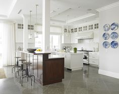 Love the idea of 2 islands in a huge open kitchen (different colors - natch) Diana Sawicki Interior Design