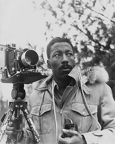 """Gordon Parks was an American photographer, film director, writer  He directed """"Shaft"""" & co-founded Essence magazine. He was the first black photographer at Life magazine & the first black director at any big Hollywood studio.  In 1937 he read an article on migrant workers: """"I saw that the camera could be a weapon against poverty, against racism, against all sorts of social wrongs. I knew at that point I had to have a camera."""" 10 years later he was the only black photographer at Vogue."""