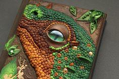 Baby dragon polymer clay leather journal - dinosaur green dragon eye golden scales A6. , via Etsy.