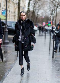 Olivia Palermo wearing a black fur coat outside Giambattista Valli on March 6 2017 in Paris France