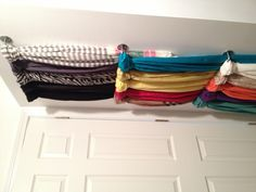 Otherwise unusable wall behind the door in my closet = perfect scarf storage