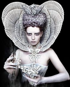 'The White Queen' by Kirsty Mitchell.   In Greek mythology, Anaxarete was a Cypriot maiden who refused the advances of a shepherd named Iphis. Anaxarete spurned him and mocked his feelings until he cried in despair and hanged himself on her doorstep. Anaxarete was still unmoved. When she mocked his funeral, calling it pitiful, Aphrodite turned her into a stone statue.