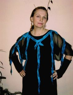 """Olga Geiser """"For years, I design and produce custom silks and in recent years I make unique pieces of silk and also felt their own designs in my studio here. My works I refer to as"""" painting with felt on silk. """"Many different shades of color in harmony with each other and play plastic attachment of shapes characterize my style. I design to very serious light textiles in which structures of fine wool create the effect. For my work, a keen sense and awareness are very important. """""""