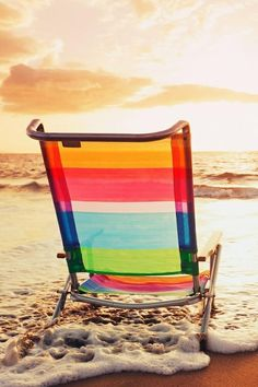 Colorful Beach Chair Resting on the Sand During the Gorgeous Sunset.....
