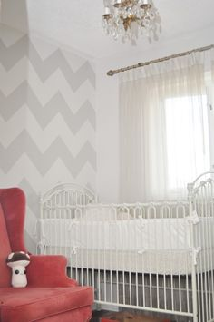 Love how this chevron accent wall is subtle and sweet in this vintage-inspired nursery! #nursery #chevron