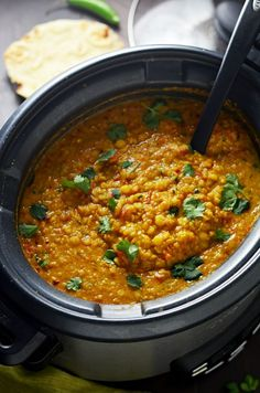 Slow Cooker IndianSpiced Lentils This crock pot dahl recipe is hearty heavily spiced and ultracomforting It doesnt require any crazy techniques but winds up so flavorful Lentil Recipes Indian, Dahl Recipe Indian, Indian Slow Cooker Recipes, East Indian Food Recipes, Indian Lentil Soup, Lentil Dahl, Slow Cooker Lentils, Slow Cooker Dal, Slow Cooker Lentil Curry