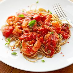 You make a simple red sauce, then add the sauteed shrimp and serve it over whole wheat pasta for this easy dinner.