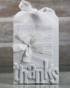 tag with sizzix. (LOVE the white on white!!   BMD)