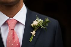 love the contrast of suit vs tie, and the dinky white rose buttonhole!