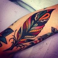 traditional style feather tattoo