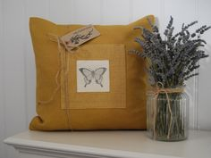 Hand made mustard cushion with hand printed butterfly appliqué by Hilly Horton Home