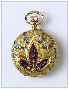 El Aguila. An 18k gold, enamel and stone set fob watch. Circa 1900. Jeweled nickel plated movement with lever escapement, enamel dial with Roman numerals and subsidiary seconds, frosted finish case with enamel highlighted relief floral design cover set with stones, floral reverse, case, dial and movement signed.