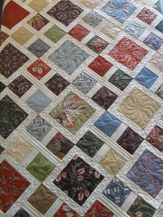 A simple quilt that is made more complicated looking with nice quilting.