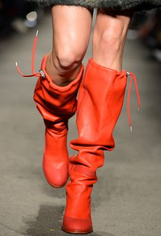 T plucks the best shoes right off the runway. Today's pick: slouchy knee-high boots in cherry leather with details inspired by fishing gear.